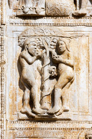 stock photo of adam eve  - Detail of marble relief of Adam and Eve  - JPG