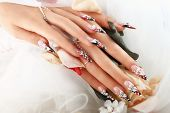 foto of nail-design  - Female hand with beautiful wedding design on nails - JPG