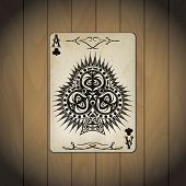 image of ace spades  - Ace of clubs poker cards old look varnished wood background - JPG