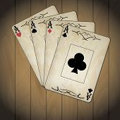 stock photo of ace spades  - Ace of spades ace of hearts ace of diamonds ace of clubs poker cards set old look varnished wood background - JPG