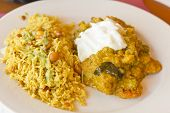 foto of tamarind  - Authentic Indian vegetable Korma topped with yogurt sauce with a side of tamarind basmati rice and peanuts - JPG