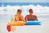 picture of tan lines  - Cute couple in swimsuit sunbathing together against hearts hanging on the line - JPG