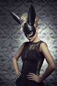picture of mask  - Sexy beautiful hot blonde woman in elegant black dress with black rabbit mask and dark makeup - JPG