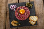 picture of tartar  - Beef tartare with capers and onions yolk with mustard