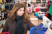 foto of san valentine  - Middle age woman browsing a department store to buy presents for San Valentine Day - JPG
