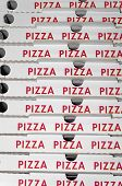 stock photo of take out pizza  - Piled pizza boxes ready for take away - JPG