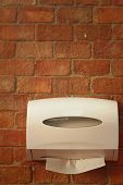 picture of tissue box  - Tissue box on a background of a brick - JPG