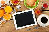 image of breakfast  - breakfast and tablet on wooden table - JPG