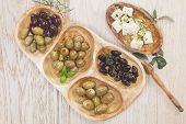 pic of kalamata olives  - Assorted olives and feta or goat cheese cheese in olive tree dish on wooden table - JPG