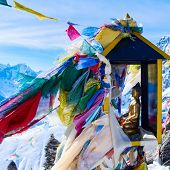 picture of dharma  - mountain scenery from gokyo ri with prayer flags and buddha statue  - JPG
