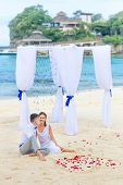 image of wedding arch  - young loving couple on their wedding day - JPG