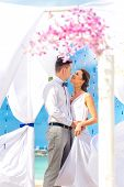 foto of wedding arch  - young loving couple on their wedding day - JPG