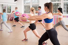 picture of pilates  - People doing exercise with ball in pilates class - JPG