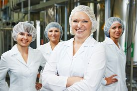 picture of pharmaceuticals  - portrait of female pharmaceutical factory worker in pharmacy industry manufacture factory - JPG
