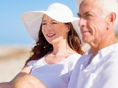 stock photo of couple sitting beach  - Couple sitting on the beach - JPG