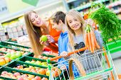 image of grocery cart  - Family selecting fruits and vegetables while grocery shopping in supermarket  - JPG