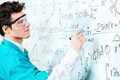 stock photo of conduction  - Young scientist conducting research - JPG