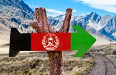stock photo of civil war flags  - Afghanistan Flag wooden sign with desert road background - JPG