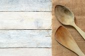 image of sackcloth  - Wooden dipper kitchenware on a sackcloth on a white wooden table of a rustic kitchen - JPG
