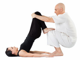 image of thai massage  - Young woman being stretched in thai position by therapist - JPG