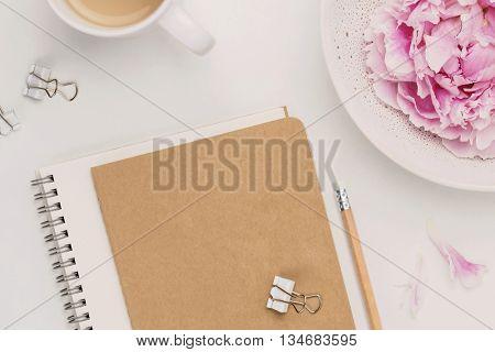 feminine minimalist notebook mock-up with coffee mug, pencil and peonies
