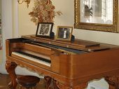 stock photo of grand piano  - old piano musical instrument in a room - JPG