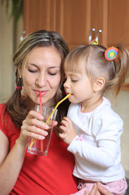 picture of drinking water  - Mom and litte child Sipping water together - JPG
