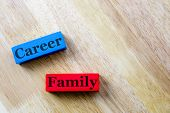 Family And Career Word Concept. Family And Career Word Written In Wooden Cube poster