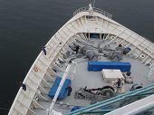 stock photo of por  - Cruise ship crew preparing ropes for arrival at the pier - JPG