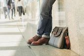 Men Wear Jeans And Leather Bags On The Street Corridors. poster