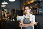 Portrait Of Barista Woman Small Business Owner Standing With Crossed Arms With Employee In Backgroun poster