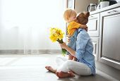 Happy Mothers Day! Baby Son Gives Flowersfor  Mother On Holiday poster