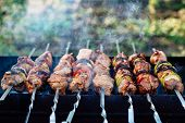 Barbecue. Juicy Shish Kebab On The Grill. Shish Kebab On Skewers Fried On Hot Coals, Aromatic Smoke  poster