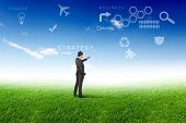 stock photo of business success  - Young businessman outdoor with business symbols on the sky background - JPG