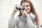 Young Woman Holding In Hands Old Vintage Camera. Girl Photographer And Film Camera.holidays, Photogr poster