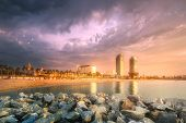 Barceloneta Beach In Barcelona With Rocky Coastline And Colorful Sky At Sunrise, Spain poster