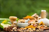 Turmeric Powder,turmeric In Mortar Grinder Drugs And Ingredient Herbs On Wooden Background poster