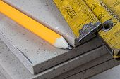 Laying And Cutting Tiles. Tools And Building Materials At A Working Position. Tiles For Industrial A poster
