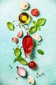 Fresh ingredients on blue stone background. Ingredients for cooking pizza, pasta sause, italian or v poster