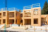 New Residential Building Under Construction. Low Rise Wooden Framework Of The Building On Concrete B poster