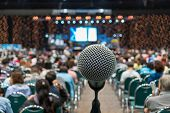 Microphone Over The Abstract Blurred Photo Of Conference Hall Or Seminar Room In Exhibition Center B poster