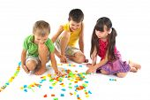 picture of children playing  - Group of children playing with letters in studio - JPG