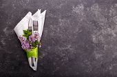 Spring Festive Table Setting With Cutlery And Lilac Flowers On Black Stone Table,copy Space Flat Lay poster