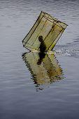 image of dauphin  - Malagasy Fishermen moving the fishing box nets Lake Vinanibe Fort Dauphin Madagascar - JPG
