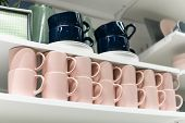 Mugs On Shelf On A Shelf In Retail Gift Store. Pink And Dark Blue Coffee Mugs On Shelf In Kitchen. S poster
