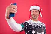 Best Phone For Party Selfie. Santa Man Make Video Call On Mobile Phone. Bearded Man Use Phone Camera poster