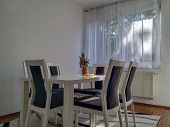 Modern Good Looking Clean And New Dining Room, Decorated In Minimalist Style, Mostly White Color Wit poster