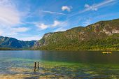 Classic Wide-angle View Of The Bohinj Lake (bohinjsko Jezero) And Scenic Mountain Gorge In The Backg poster