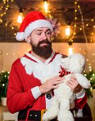 Santa Claus Play With Soft Toy Teddy Bear. Christmas Charity. Kindness And Generosity. Charity Help. poster