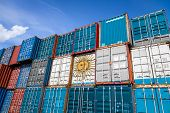 The National Flag Of Argentina On A Large Number Of Metal Containers For Storing Goods Stacked In Ro poster